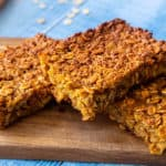 Best pumpkin baked oatmeal - 3 pieces on a cutting board