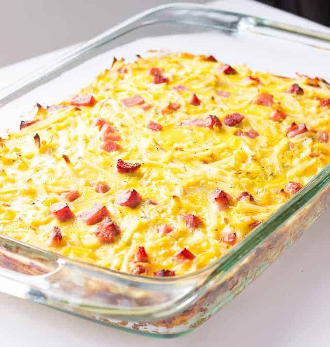 Baked Egg Casserole with ham and cheese in a baking dish
