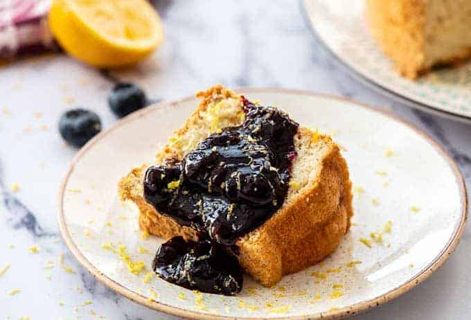 Blueberry Syrup on angel food cake on a plate