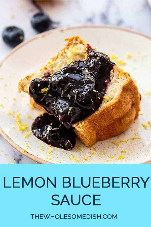 Lemon Blueberry Sauce Recipe poured over angel food cake on a plate