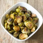 Maple Roast Brussels Sprouts in a white serving bowl