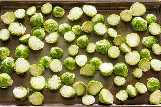 Baking sheet full of brussels sprouts for roasting