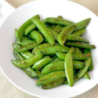 Sugar Snap Peas with Garlic in a white serving bowl