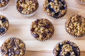 oatmeal muffins with different toppings on a cutting board