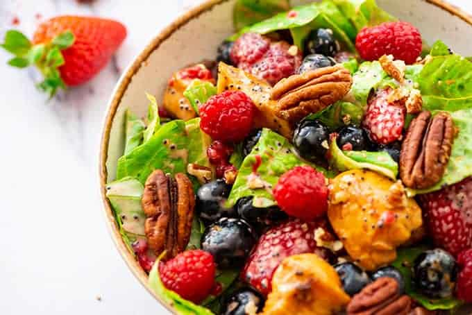 Poppyseed Berry Salad with chicken in a bowl