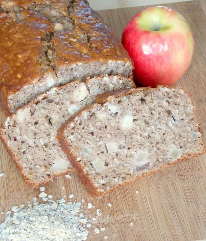 sliced Apple Cinnamon Oatmeal Bread on a cutting board