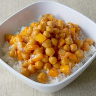 Coconut Curry Garbanzo Beans over white rice in a bowl