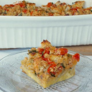 a piece of tomato parmesan breakfast casserole on a plate