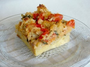 slice of tomato basil bread pudding on a plate