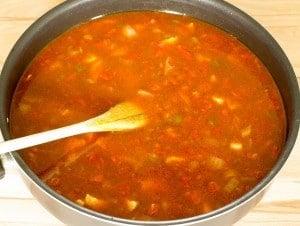 chicken enchilada ingredients in a skillet