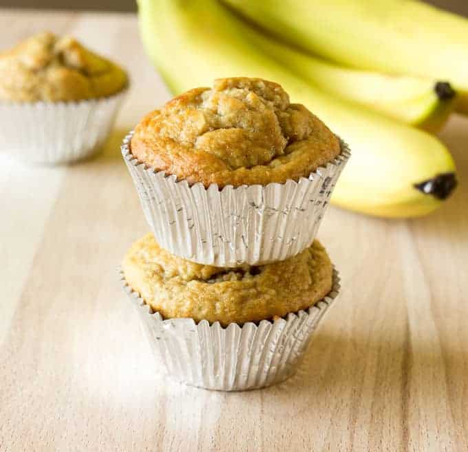 2 Banana Peanut Butter Oat Muffins stacked on top of each other