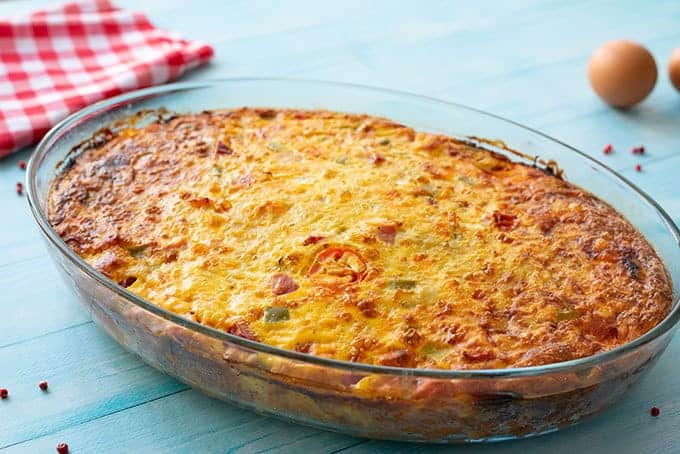 Baked cheesy hash brown breakfast casserole in a baking dish