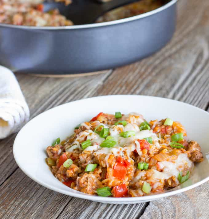 white bowl full of One Pot Wonder Stuffed Pepper Skillet