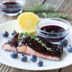 piece of blueberry balsamic glazed salmon on a white plate