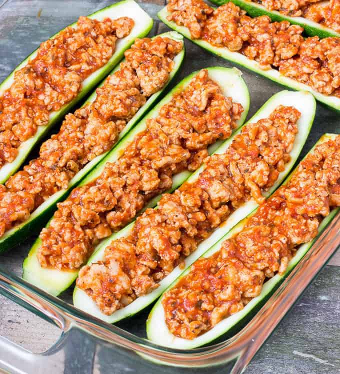baking dish full of uncooked Chicken Parmesan Zucchini Boats