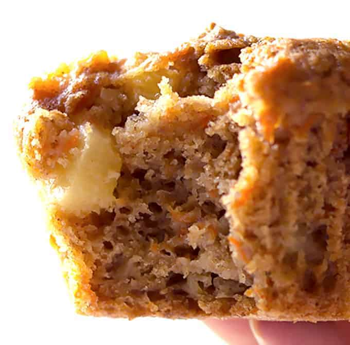 close up of a bite taken out of a Carrot Cake Muffins