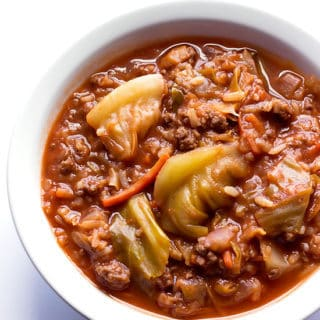 bowl of soup with ground beef, cabbage, vegetables, and rice