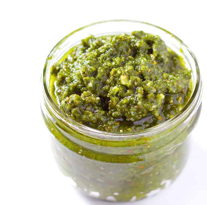 glass jar full of Basil Pesto with Almonds