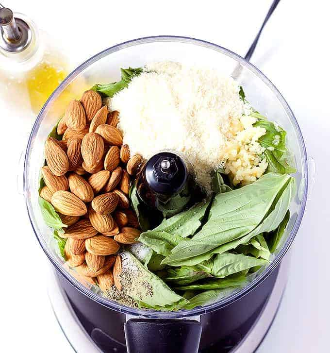 food processor full of Basil Pesto with Almonds ingredients