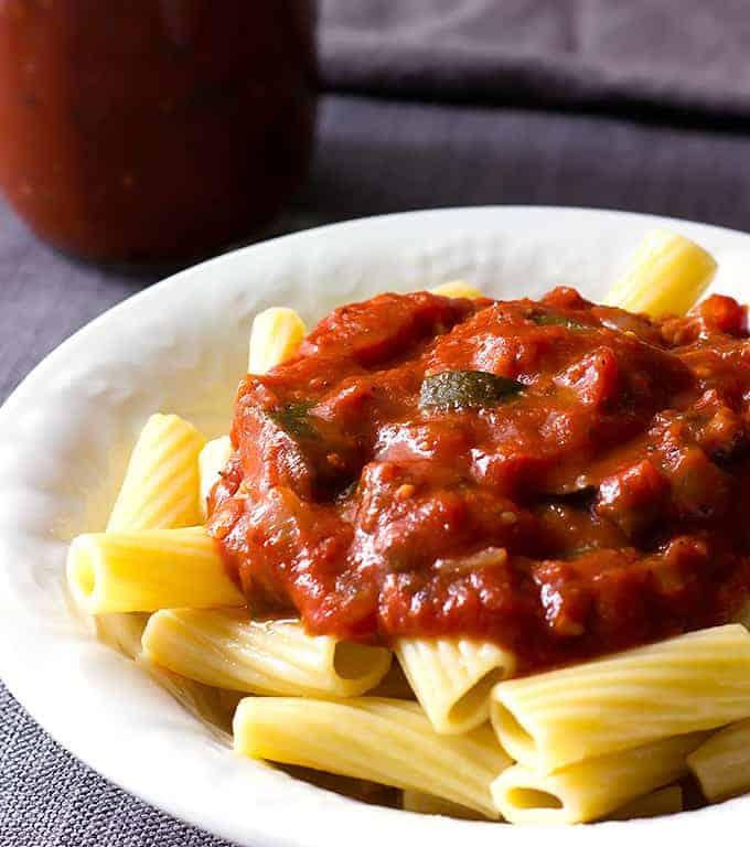 white bowl full of pasta topped with Zucchini Mushroom Pasta Sauce