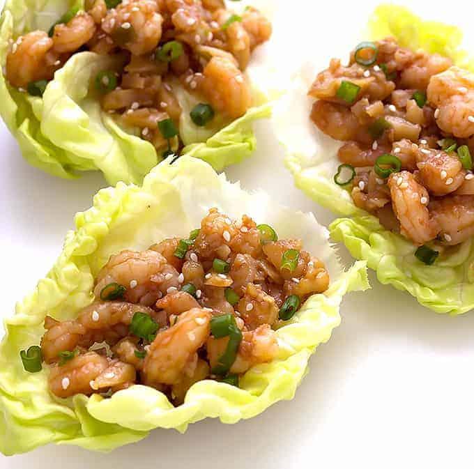 3 Hoisin Shrimp Lettuce Wraps on a white board