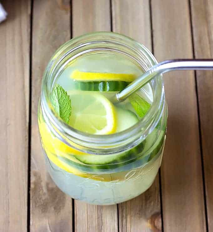 mason jar full of Cucumber Mint Lemonade  with a straw