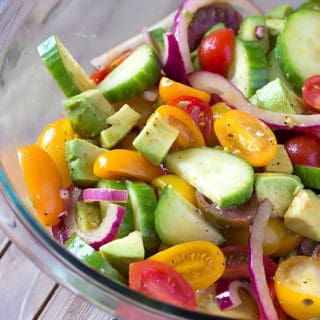 bowl of avocado tomato cucumber salad with balsamic dressing