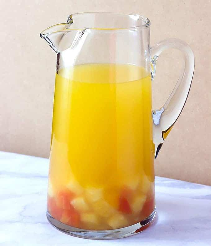 glass pitcher full of Tropical Sangria