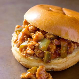 BBQ chicken sloppy joe sandwich on a grey board