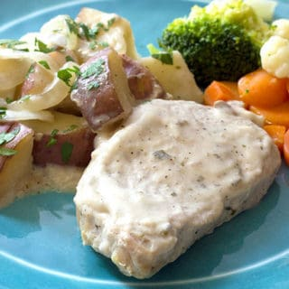 Creamy Crock Pot Pork Chops Potatoes & Onions