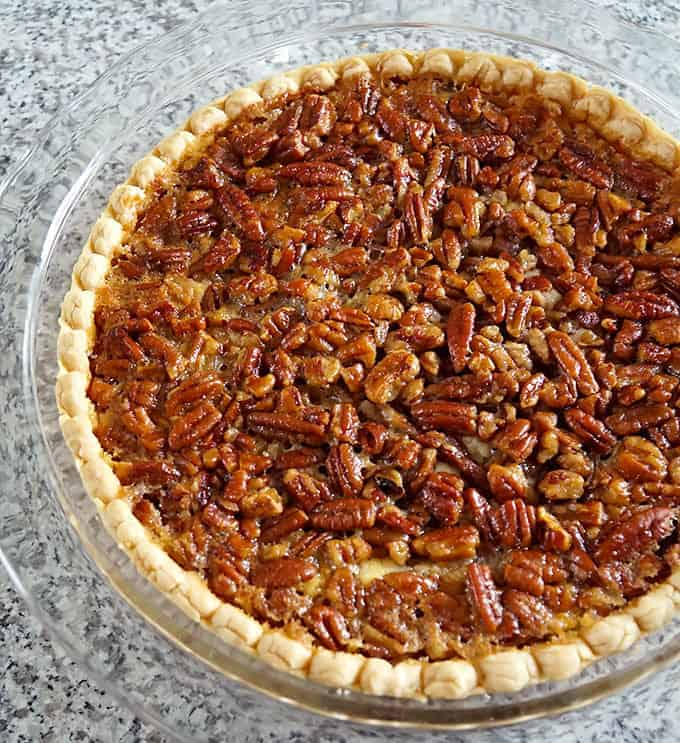 whole Cheesecake Stuffed Pecan Pie in a pie plate