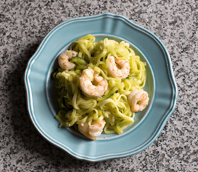 overhead shot of Lemon Garlic Shrimp & Zucchini Noodles on a blue plate