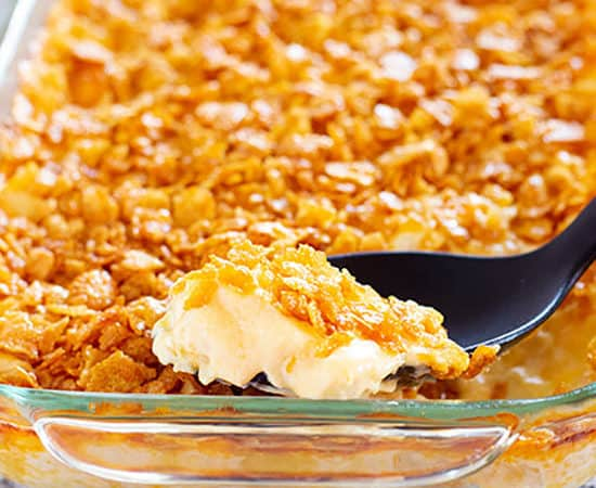 cheesy potato casserole with corn flake topping