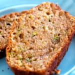 two slices of the best zucchini bread recipe on a blue plate