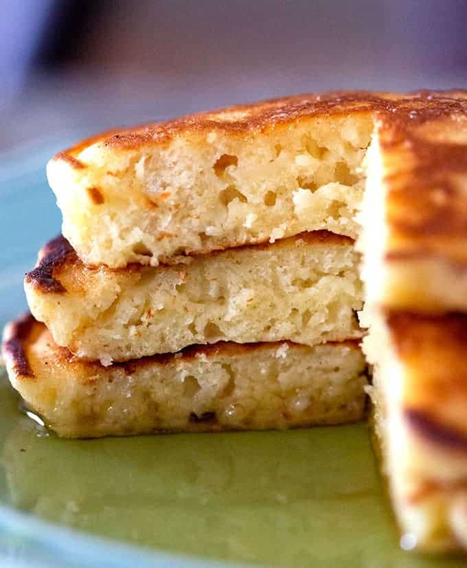 Close up of the soft fluffy insides of three stacked pancakes