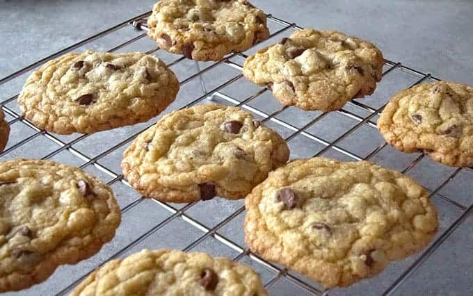 Batch of the best easy chocolate chip cookies recipe cooling on a rack