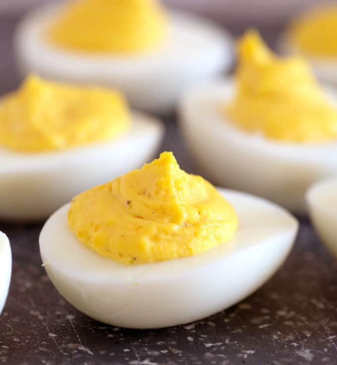 Deviled eggs on a cutting board