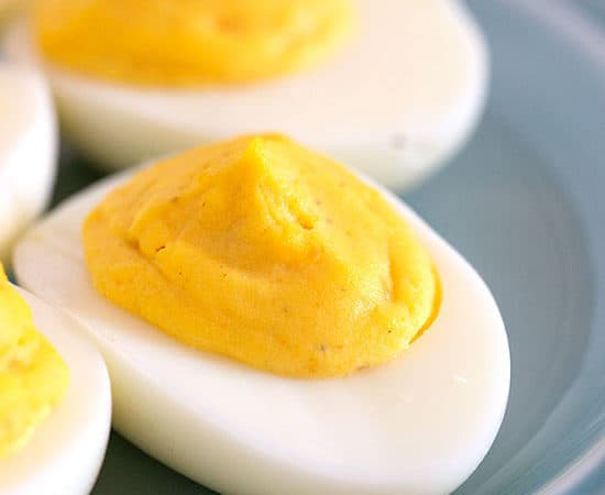 Deviled eggs on a blue plate from the best deviled egg recipe