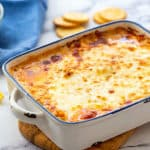 Baking dish full of hot cheesy buffalo chicken dip