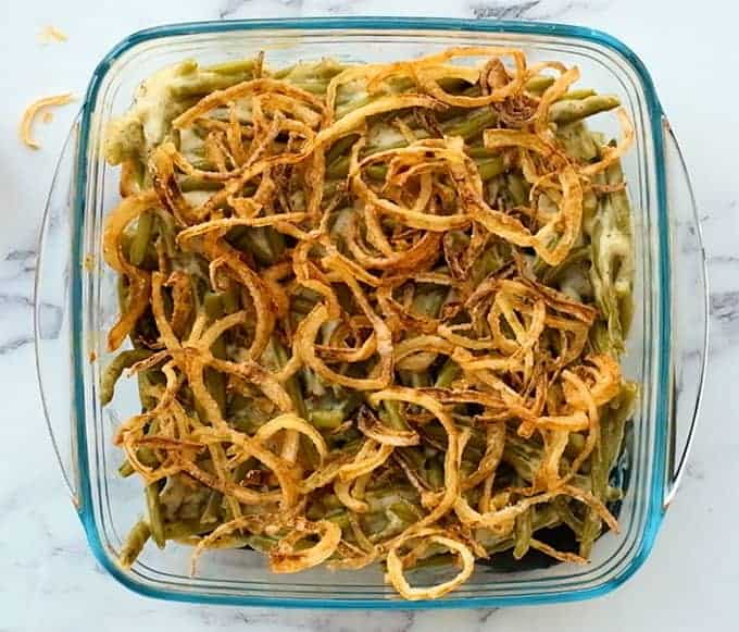 baking dish of baked green bean casserole with fried onions on top