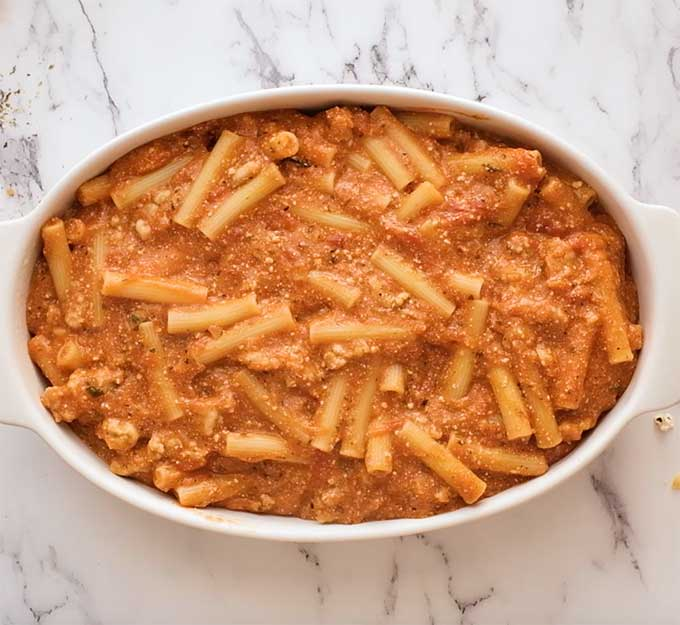 Baking dish of ziti in meat sauce