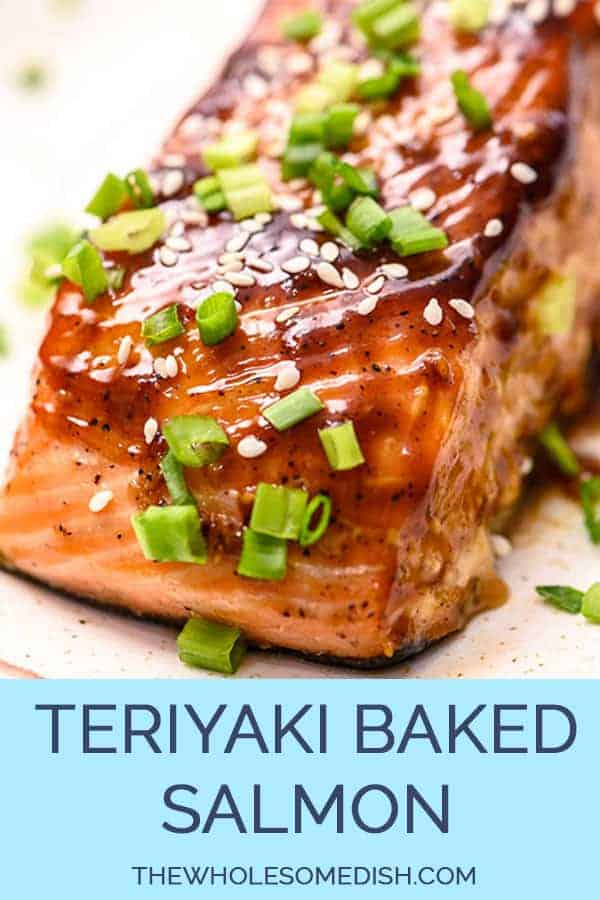 Baked teriyaki salmon on a plate sprinkled with sesame seeds and sliced green onions