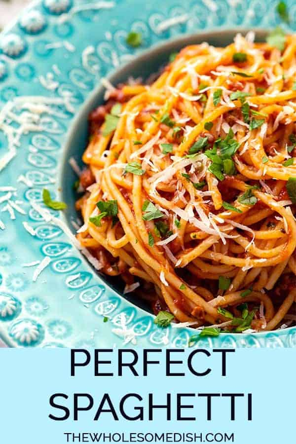spaghetti with meat sauce in a blue bowl with text overlay
