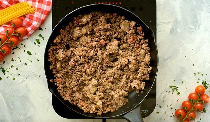 ground beef and italian sausage cooking in a skillet
