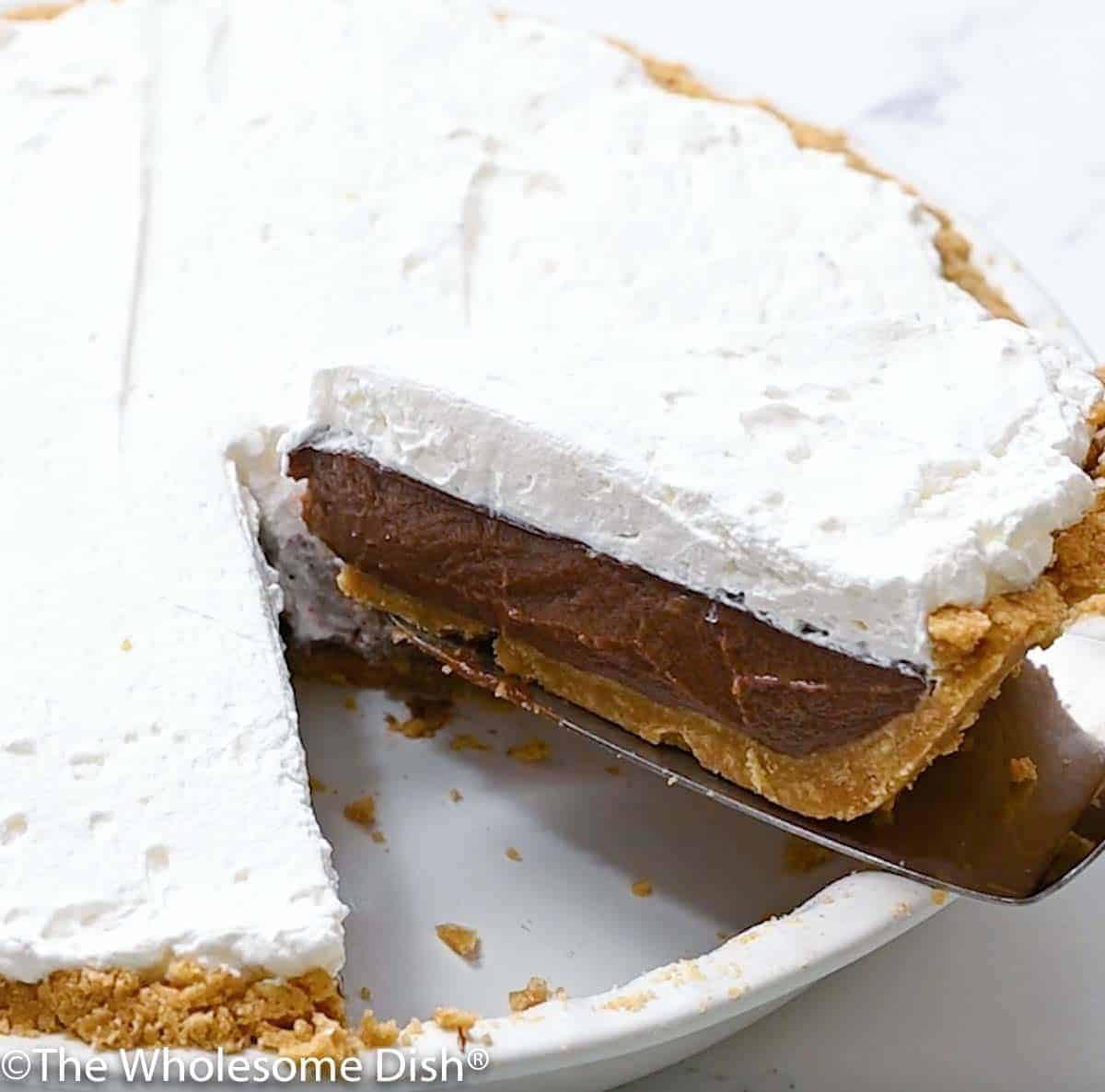 a slice of chocolate cream pie being lifted out of the pie plate