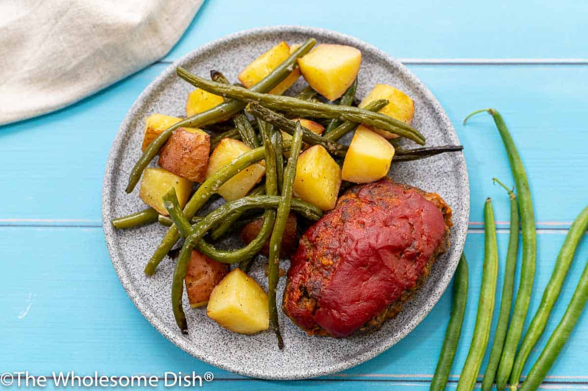 Mini meatloaf, roasted potatoes, and green beans on a plate
