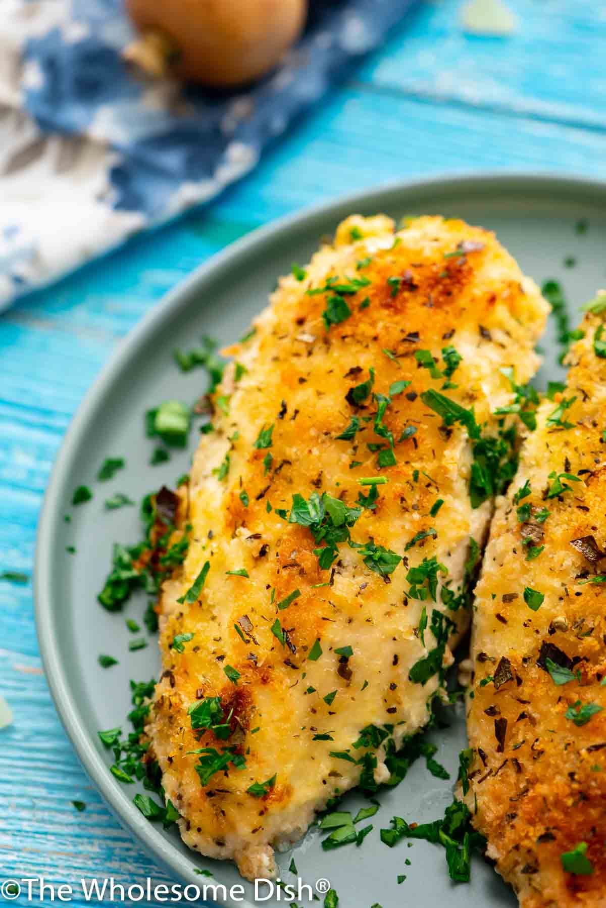 baked parmesan crusted chicken breast on a plate